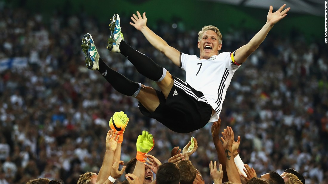 German soccer player Bastian Schweinsteiger is lifted by teammates after playing his last international match against Finland on Wednesday, August 31.