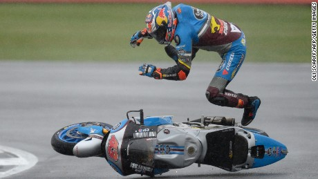 TOPSHOT - Marc VDS Racing Team's Australian rider Jack Miller comes off his Honda during MotoGP qualifying at the motorcycling British Grand Prix at Silverstone circuit in Northamptonshire, southern England, on September 3, 2016.   / AFP / OLI SCARFF        (Photo credit should read OLI SCARFF/AFP/Getty Images)