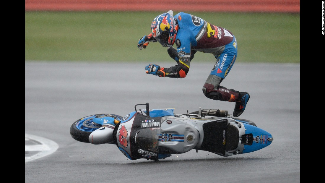 Jack Miller is thrown off his motorcycle during a British Grand Prix qualifying race in Northamptonshire, England, on Saturday, September 3.