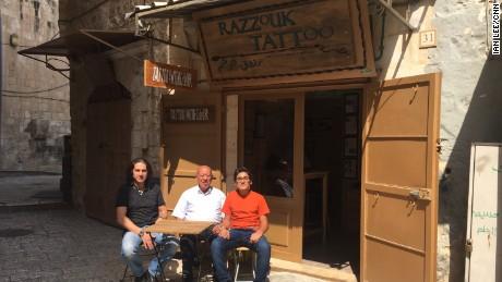 Three generations of Razzouks outside their shop