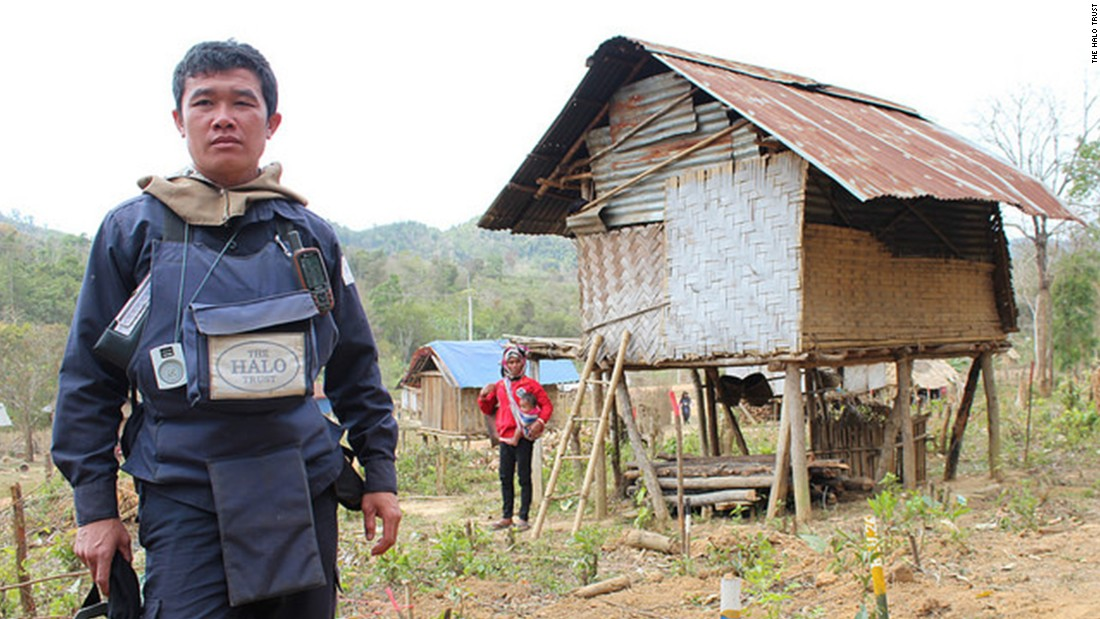 A HALO supervisor shows where the organization has found items of unexploded ordnance -- the yellow sticks indicate how close they are to one village house.