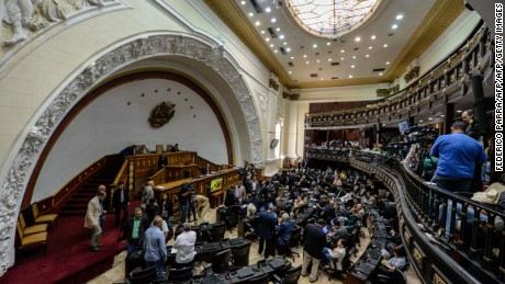 Venezuelan deputies get ready to begin an ordinary session at the National Assembly in Caracas on August 4, 2016. / AFP / FEDERICO PARRA        (Photo credit should read FEDERICO PARRA/AFP/Getty Images)