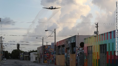 MIAMI, FL - AUGUST 06:  A plane sprays pesticide over the Wynwood neighborhood in the hope of controlling and reducing the number of mosquitos, some of which may be capable of spreading the Zika virus on August 6, 2016 in Miami, Florida. This is the second round of aerial spraying in the area as the county continues to try and prevent the Zika virus from spreading. The CDC has advised pregnant women to avoid the area.  (Photo by Joe Raedle/Getty Images)