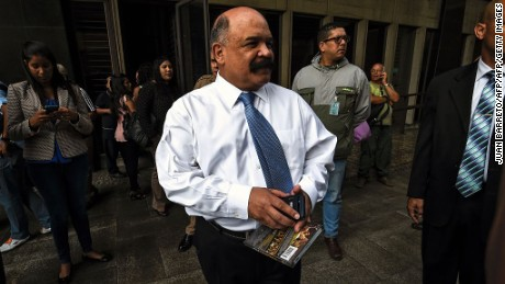 The president of the Venezuelan Central Bank (BCV) Nelson Merentes is seen after a gunman entered the building and wounded security personnel in Caracas on June 20, 2016. / AFP / JUAN BARRETO        (Photo credit should read JUAN BARRETO/AFP/Getty Images)
