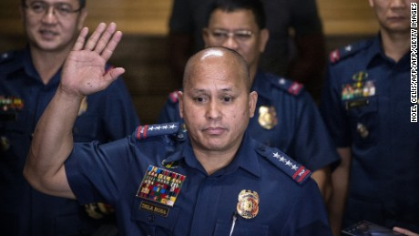 Philippine National Police (PNP) chief director general Ronald Dela Rosa (front) gestures as he speaks during a press conference at PNP headquarters in Manila on July 6, 2016. Dela Rosa spoke after talking with the three of the five top police officials who were publicly named by Philippine President Rodrigo Duterte on July 5 saying they should be investigated for involvement in illegal drugs. / AFP / NOEL CELIS        (Photo credit should read NOEL CELIS/AFP/Getty Images)