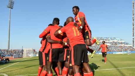 Uganda's players celebrate after midfielder Luwagga Kizito scored a goal during the AFCON 2017 qualifying match Botswana vs Uganda at the Francistown Stadium in Botswana on 4 June 2016.   / AFP / MONIRUL BHUIYAN        (Photo credit should read MONIRUL BHUIYAN/AFP/Getty Images)