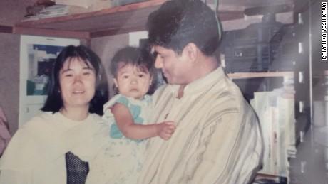 Priyanka Yoshikawa with her parents as a toddler.
