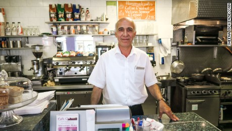 Turkish cafe owner Osal Bertiz, 53, has lived in the UK for 13 years. His staff includes four Romanians, three Turks and a Lithuanian.