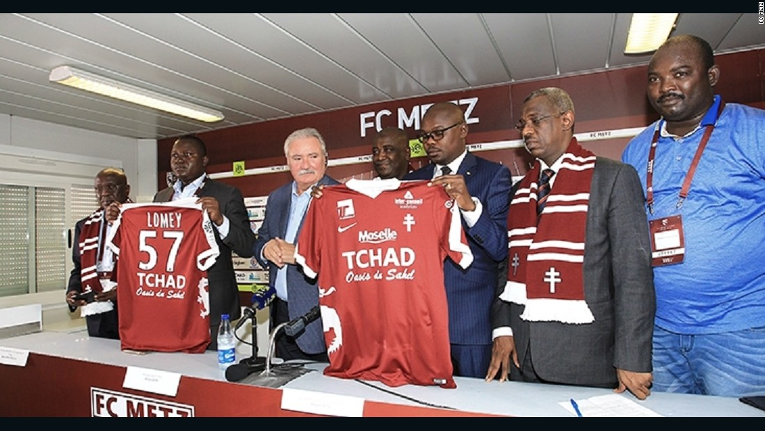 """FC Metz President Bernard Serin appears with Chad Minister of Culture, Youth and Sport Betel Miarom to announce the sponsorship agreement, which will see the French club play with """"Chad: Oasis of the Sahel"""" on the team shirts. <br /><br />Chadian officials believe the deal will improve their public image and encourage tourism to the Central African state."""