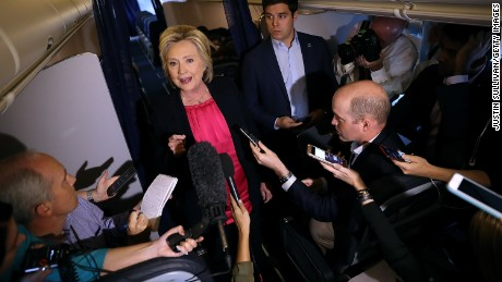 Hillary Clinton speaks to members of the media aboard her campaign plane on September 6, 2016 while in flight from White Plains, New York.