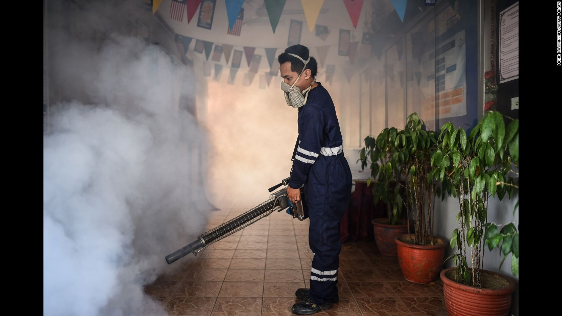 A pest control worker fumigates a school corridor on the eve of the annual national Primary School Evaluation Test in Kuala Lumpur on Sunday, September 4. Malaysia reported its first locally transmitted Zika case on September 3.