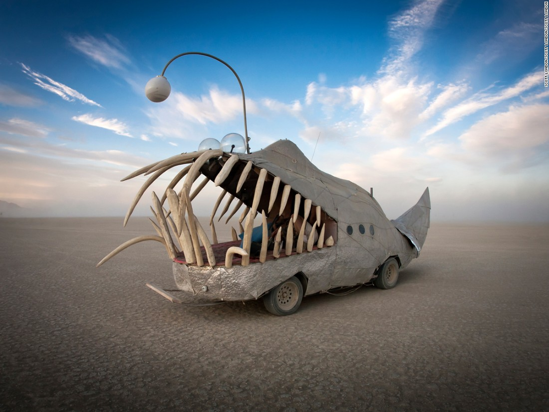"Photographer Scott London has spent over a decade documenting the Burning Man festival, held annually in Nevada's Black Rock Desert. One of his main subjects is capturing the event's bizzare Mutant Vehicles. Scroll through the gallery to see and read his thoughts about each art car he photographed. <br /><br />""Anglerfish are deep-ocean creatures with razor sharp teeth and luminescent lures hanging in front of their jaws to attract prey. It's a recurring motif at Burning Man. This fearsome-looking vehicle was created by Northern California metal artist Mark Whitman."""