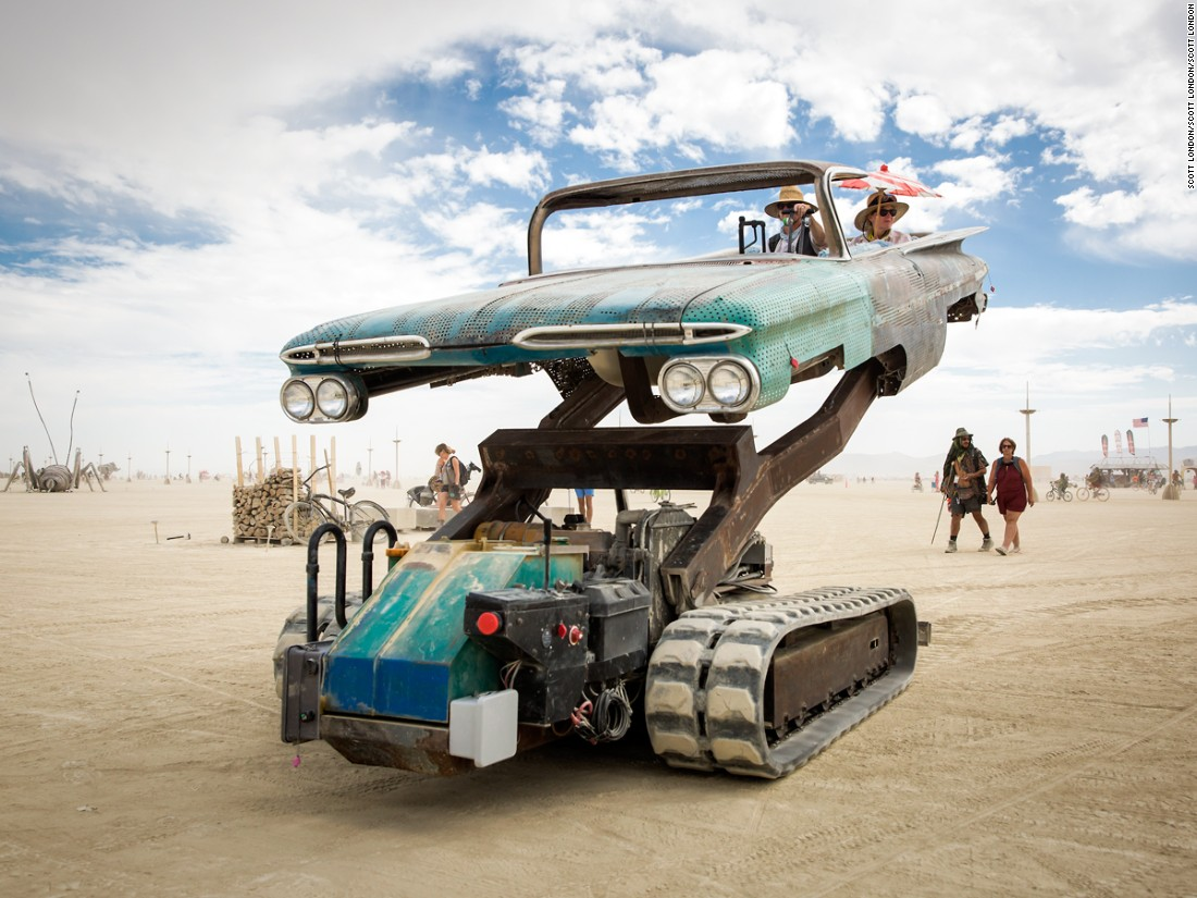 """Artist Bruce Tomb created this startling mutant vehicle by mating an excavator to an old El Camino and joining them by<br />an armature lifting passengers high off the ground and tilting them at odd angles."""