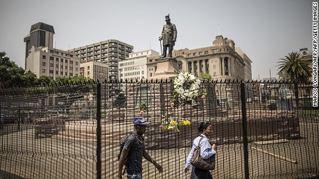 Paul Kruger's statue stands behind barbed wire in Church Square.