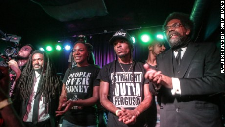 Darren Seals, second from right, appears with fellow activists, from left, the Rev. Osagyefo Sekou, Bree Newsome and Dr. Cornel West during a benefit hip-hop concert in St. Louis last year.