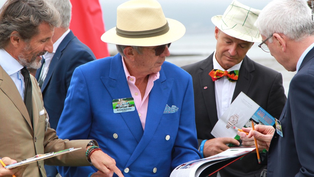The look for car collectors and judges at the Concours is decidedly dapper, with most sporting some version of the straw Panama. The man in the colorful bowtie is Bugatti design director Achim Anscheidt.