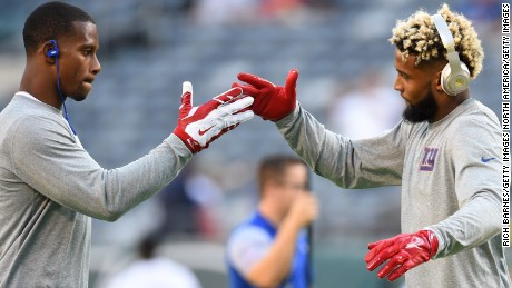 Wide receivers Victor Cruz (L) and Odell Beckham of the New York Giants engaged in a choreographed pregame handshake, one of many rituals which NFL players will embrace throughout the season.