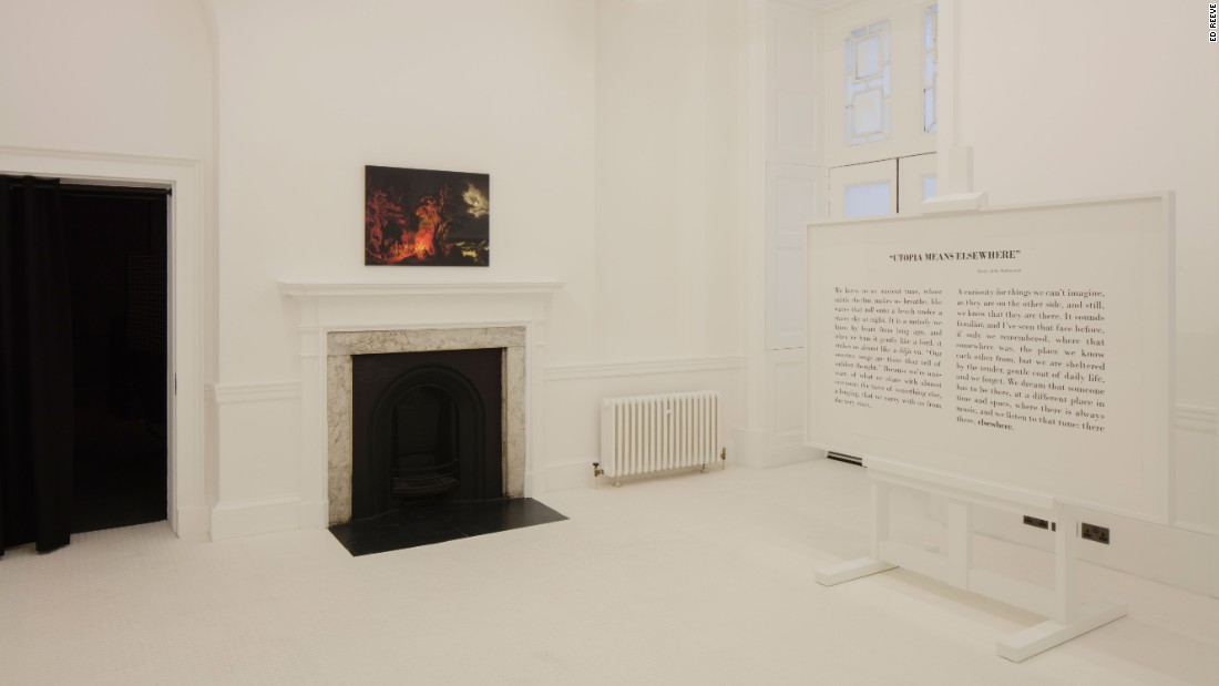 "Germany's installation by designers Konstantin Gric and Olivia Herms, takes the shape of two opposing rooms: the first is a simply outfitted, bright white space showcasing the John Malchovich quote ""Utopia means elsewhere"".<br />"