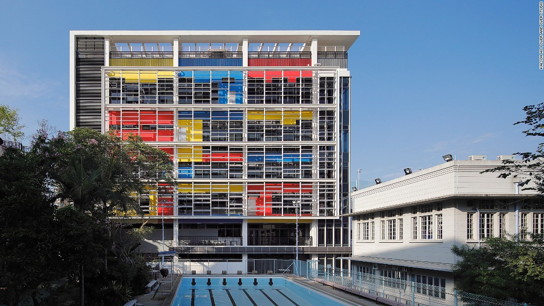 This striking redevelopment of an existing campus in high-density Hong Kong features louvered screens that improve the penetration of sunlight and ventilation, and vertical greening gardens in breakout spaces, which enlarge green areas at the school.