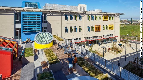 The private Nueva School at Bay Meadows, California in the USA uses existing public resources -- like community playing fields and libraries -- and makes their own spaces available for public use in return.