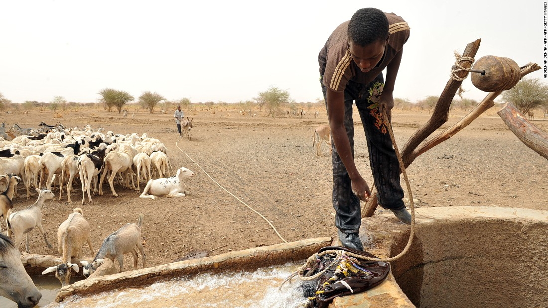 "A Bedouin takes water from a well near Nema, southeastern Mauritania, 2012. The West African nation has retained one cultural trait that was dominant during the time of Mansa Musa I: slavery (<a href=""http://edition.cnn.com/interactive/2012/03/world/mauritania.slaverys.last.stronghold/"">which is illegal, but widespread)</a>. Jubber writes of his hopes that ""the future will be very different,"" and the region will regain its great wealth from sources such as solar energy instead."
