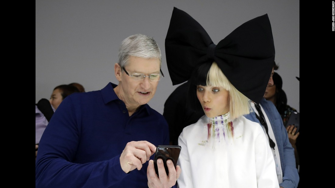"Apple CEO Tim Cook, left, shows an iPhone 7 to performer Maddie Ziegler during the company's annual press event in San Francisco on Wednesday, September 7. <a href=""http://money.cnn.com/2016/09/07/technology/apple-iphone-7-launch/"" target=""_blank"">Apple unveiled</a> the new iPhone 7 smartphone and a new, waterproof Apple Watch, among other products."