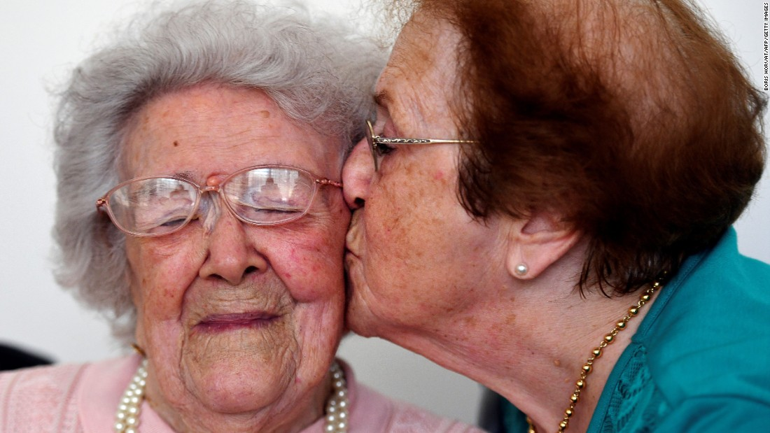 Eighty-five-year-old Yvette Florens, right, kisses her 113-year-old mother, Honorine Rondello, at a retirement home in Saint-Maximin-la-Sainte-Baume, France, on Wednesday, September 7. Born in Paimpol, France, on July 28, 1903, Rondello is now the oldest person in France.