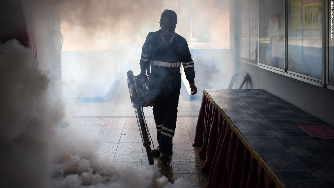 A pest control worker fumigates a classroom in Kuala Lumpur, Malaysia, on Sunday, September 4.