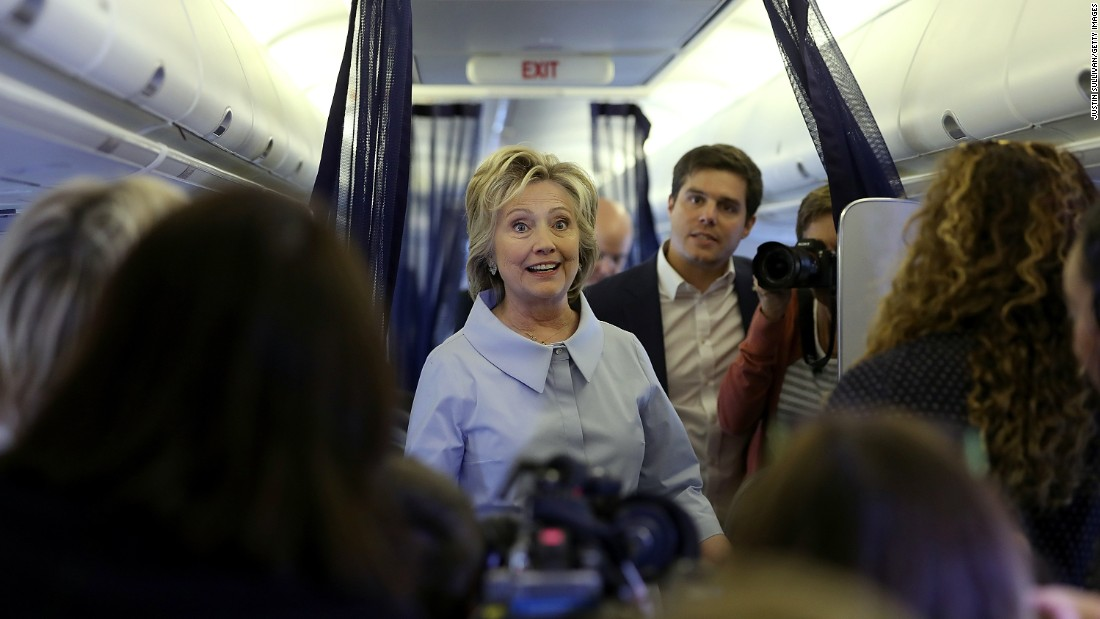 Democratic presidential nominee Hillary Clinton talks with reporters aboard her new campaign plane at Westchester County Airport in White Plains, New York, on Monday, September 5.