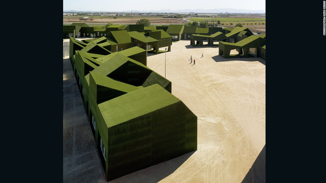 Located on the outskirts of this small town in Murcia, Spain, this school is fully wrapped in a green carpet of artificial turf, and is built on top of a two-meter high perimeter wall to protect it from the region's heavy rains. (Photo credit: David Frutos)
