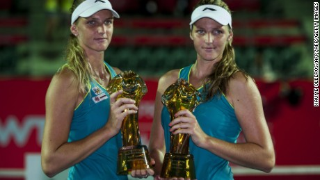 Sisters Karolina (R) and Kristyna Pliskova (L) of Czech Republic pose for media after winning against Patricia Mayr-Achleitner Austria and Arina Rodionova from Australian after their women's final doubles tennis match at the Hong Kong Open on September 14, 2014. AFP PHOTO / XAUME OLLEROS        (Photo credit should read XAUME OLLEROS/AFP/Getty Images)