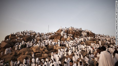 Muslim pilgrims gather on Mount Arafat near Mecca as they perform one of the Hajj rituals late on October 3, 2014. The pilgrims perform a series of rituals during the annual Hajj. They circumambulate the kaaba seven times, runs back and forth between the hills of Al-Safa and Al-Marwah, drink from the Zamzam Well, goes to the plains of Mount Arafat to stand in vigil, and throws stones in a ritual Stoning of Devil. The pilgrims then shave their heads, perform a ritual of animal sacrifice, and celebrate Eid al-Adha holiday.  AFP PHOTO/MOHAMMED AL-SHAIKH        (Photo credit should read MOHAMMED AL-SHAIKH/AFP/Getty Images)