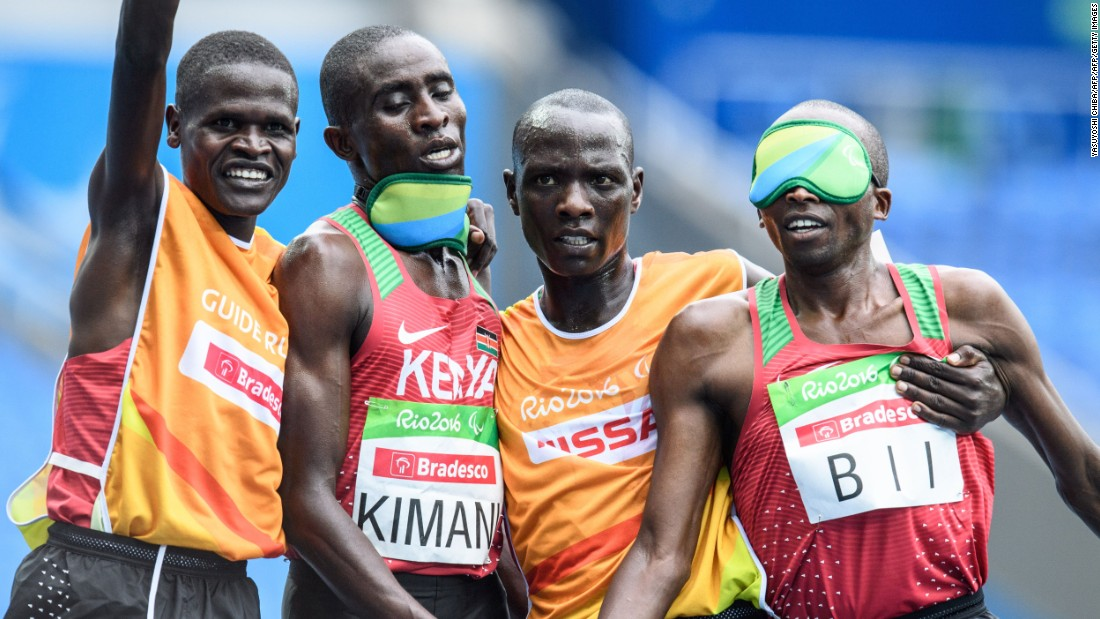 Kenya's Samwel Kimani (2L) and guide James Boit (L) got the medal procession under way in Rio, winning the first gold of the Paralympic Games in the men's T11 5,000m.