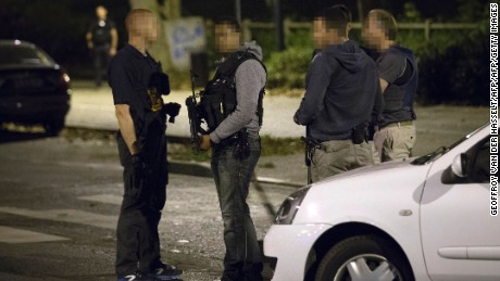 French police officers stand on the site in Boussy-Saint-Antoine on September 8, 2016 where female suspects who have been planning new acts of violence were arrested. A woman wanted in connection with the discovery of a car found near Notre Dame cathedral in Paris containing six gas canisters was shot and arrested by police south of the capital, an inquiry source said. The woman seized in Boussy-Saint-Antoine was one of the car owner's daughters, the source said, adding that a police officer suffered a knife wound during the arrest. Two other women were also held.  / AFP / GEOFFROY VAN DER HASSELT        (Photo credit should read GEOFFROY VAN DER HASSELT/AFP/Getty Images)