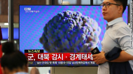 A man walks past a television screen showing a news broadcast on North Korea's nuclear test at Gimhae International Airport in Busan, South Korea, on Friday, Sept. 9, 2016. North Korea conducted its fifth nuclear test on Friday, the anniversary of the reclusive nation's founding, and said it was now able to produce miniaturized nuclear arms. Photographer: SeongJoon Cho/Bloomberg via Getty Images