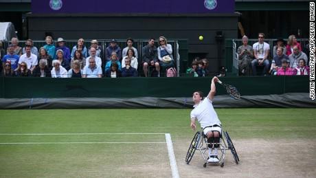 Reid serves against Swede Stefan Olsson during the Wimbledon men's wheelchair singles final.