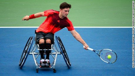 NEW YORK, NY - SEPTEMBER 10:  Gordon Reid of Great Britain returns a shot to Shingo Kunieda of Japan during their Men's Wheelchair Singles Quarterfinals matchon Day Eleven of the 2015 US Open at the USTA Billie Jean King National Tennis Center on September 10, 2015 in the Flushing neighborhood of the Queens borough of New York City.  (Photo by Alex Goodlett/Getty Images)
