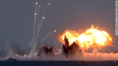 Russia's military jets and navy ships take part in military exercises in Crimea on September 9, 2016.