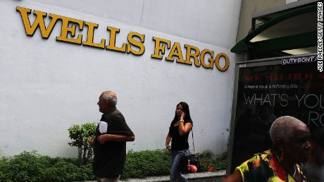 A Wells Fargo sign is seen on the exterior of one of their bank branches on September 9 Miami, Florida.  Reports indicate that more than 5,000 Wells Fargo employees have been fired as a result of a scandal involving employees that secretly set up new fake bank and credit card accounts in order to meet sales targets.