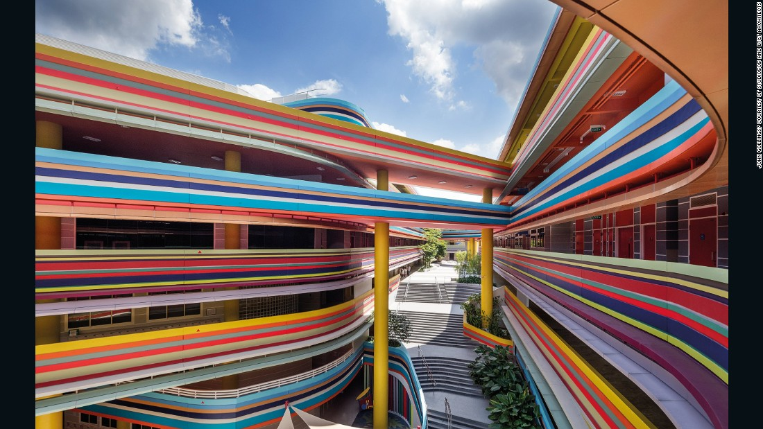 This eye-catching, colorful extension and rebuild of an existing primary school and kindergarten in Singapore was designed around a generous internal communal space.