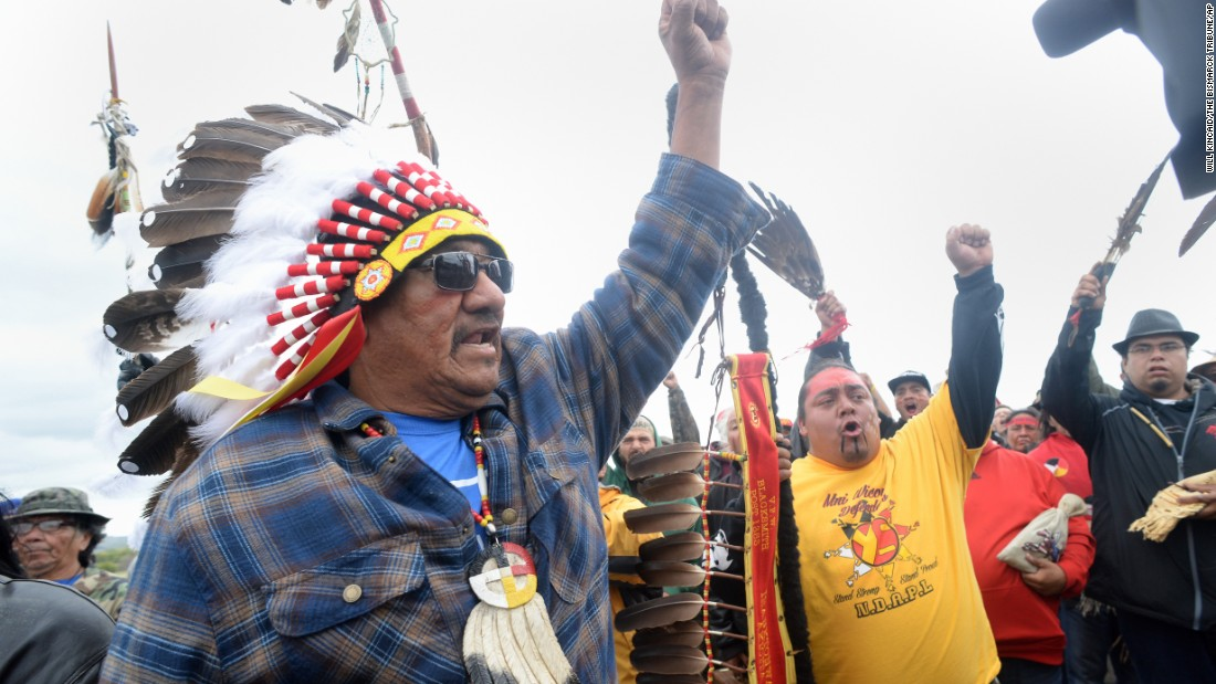 "JR American Horse raises his fist with others while leading a march to the Dakota Access Pipeline site in southern Morton County, North Dakota. Several hundred protesters marched about a mile up Highway 1806 on Friday, September 9, to the <a href=""http://www.cnn.com/2016/09/07/us/dakota-access-pipeline-visual-guide/"" target=""_blank"">area of the pipeline site</a>."