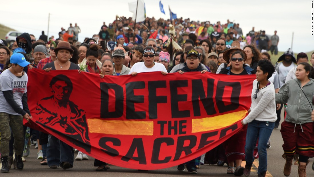 Native Americans on September 4 march to the site of a sacred burial ground near Cannon Ball, North Dakota. Those seeking to halt construction warn of an environmental disaster that would destroy sacred Native American sites.