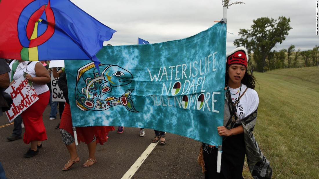 Native Americans march to the site of a sacred burial ground on September 4. Standing Rock Sioux Chairman David Archambault II said he doesn't support moving more crude oil from North Dakota. He told CNN affiliate KFYR that Americans should look for alternative and renewable sources of energy.