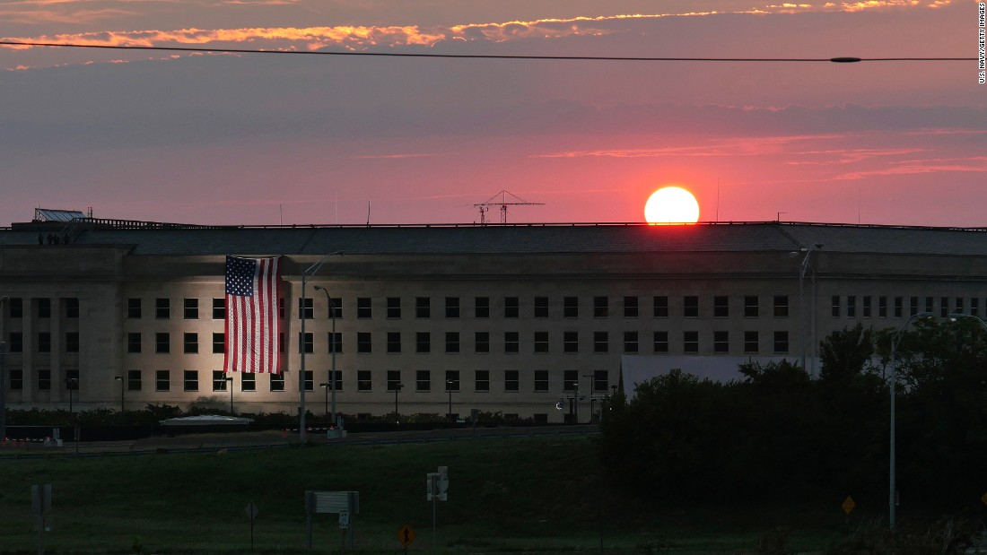 Sunrise at the Pentagon prior to a ceremony to commemorate the 15th anniversary of the September 11, 2001 terror attacks. The American flag is draped over the site of impact at the Pentagon. The Pentagon Memorial commemorates the 184 lives lost at the Pentagon and onboard American Airlines Flight 77 during the terrorist attacks.