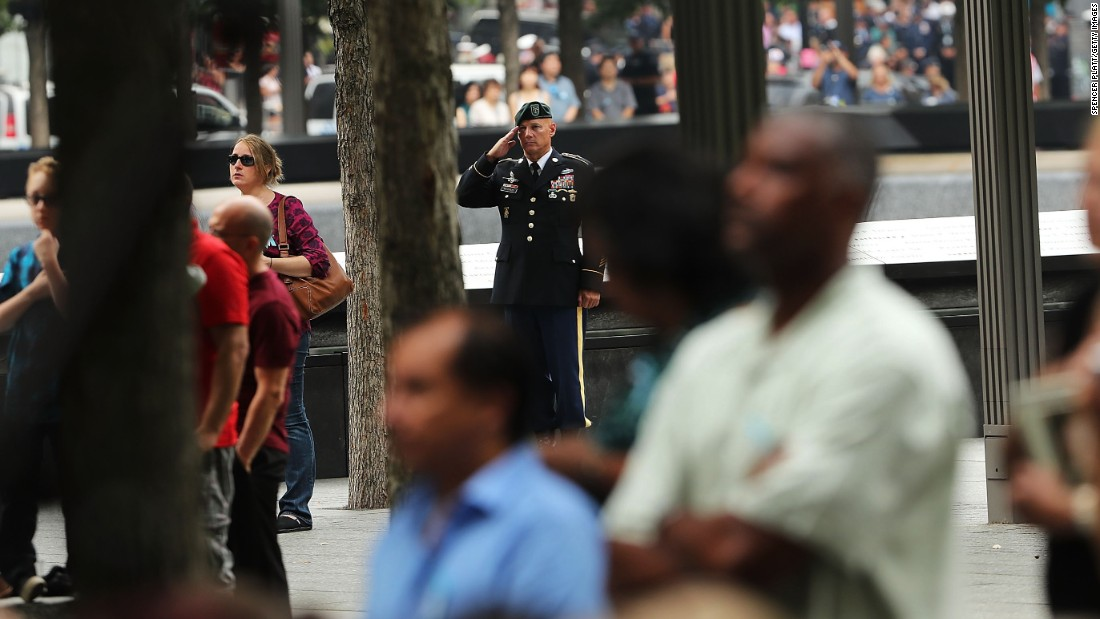 An Army service member salutes during the a ceremony remembering the victims of the September 11 terrorist attacks at the National September 11 Memorial and Museum.