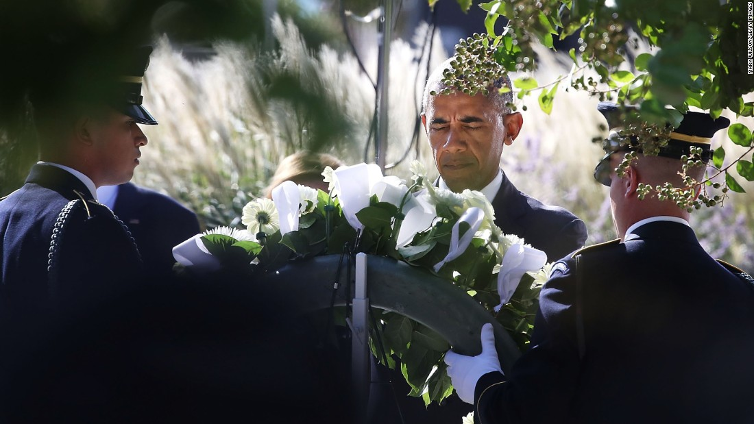 President Barack Obama lays a wreath during a ceremony to mark the 15th anniversary of the 9/11 terrorists attacks at the Pentagon Memorial September 11, 2016 in front of the Pentagon in Arlington, Virginia.