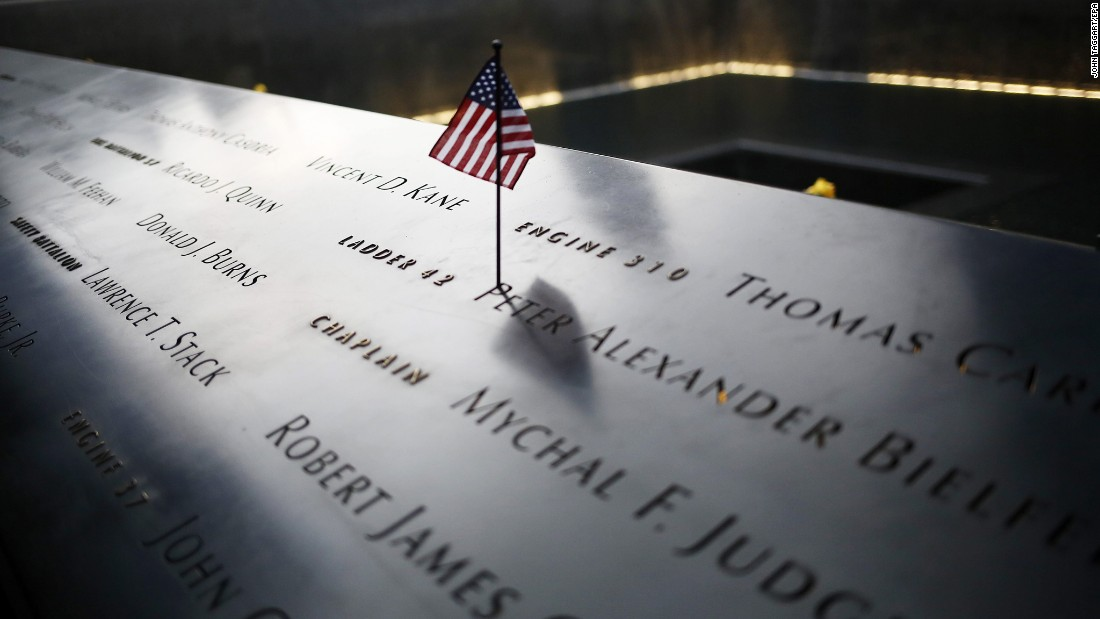 An American flag stands among names on the 9/11 memorial before the start of the 15th anniversary memorial service to 9/11 victims in New York.