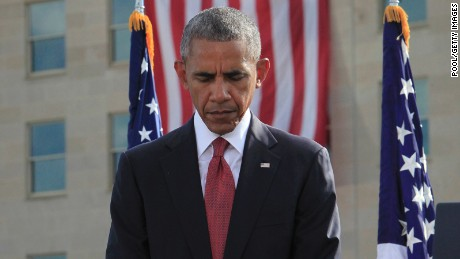 President Barack Obama participates in a moment of silence during a ceremony to mark the 15th anniversary of the 9/11 terrorists attacks at the Pentagon Memorial September 11, 2016 in front of the Pentagon in Arlington, Virginia.