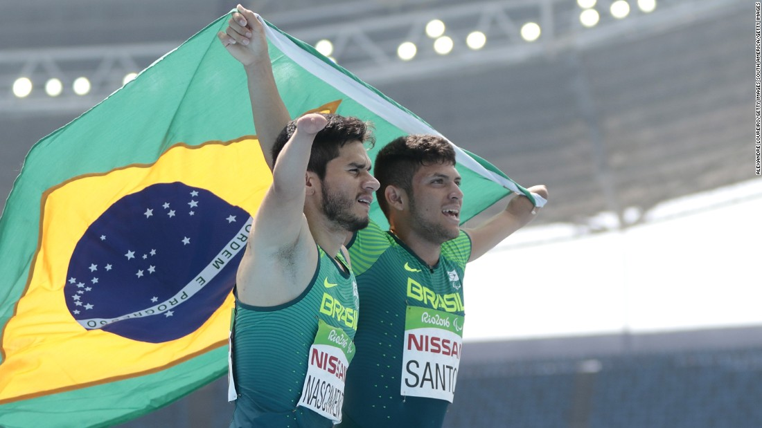 Yohansson Nascimento (L) celebrates his bronze medal with gold medalist Petrucio Ferreira dos Santos after the T47 100m final meter. They were just two of four sprint medalists the host nation got to celebrate Sunday.