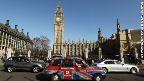 LONDON, ENGLAND - MARCH 26:  A taxi with a Union Flag livery drives through Parliament Square on March 26, 2012 in London, England.  (Photo by Oli Scarff/Getty Images)